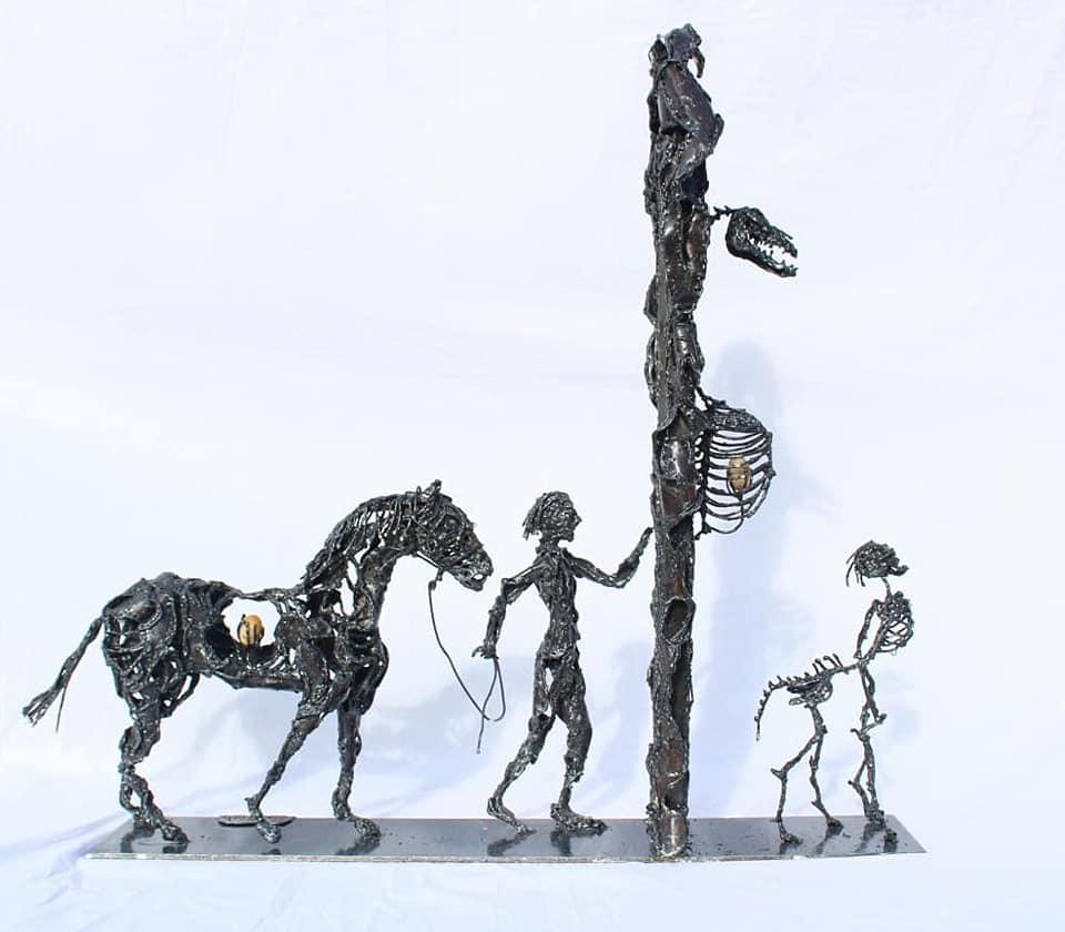 Sculpture de cheval et son humain en fusion